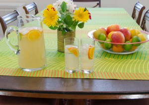 Lemonade pitcher and glasses on table pads