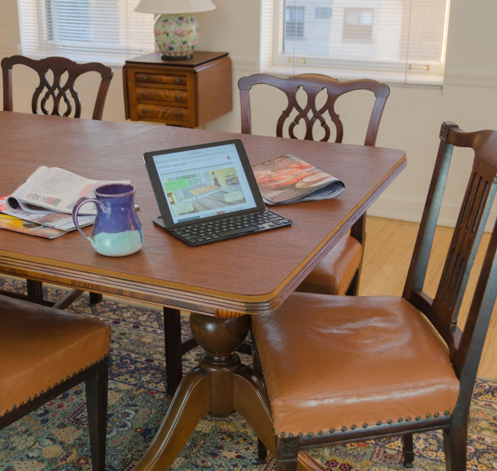 Dining Room Table Pads with coffee cup and laptop
